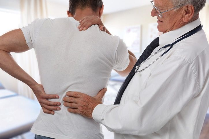 Back Pain Doctor with Patient