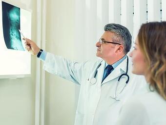 Lithonia Chiropractor Looking at Neck and Spine x-rays
