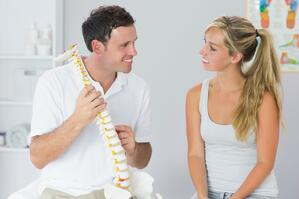 Chiropractor in Sandy Springs Talking to Patient About Back Pain
