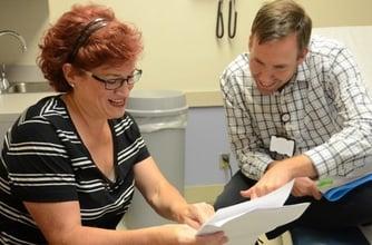 Chiropractor talking patient about low back pain symptoms.jpg