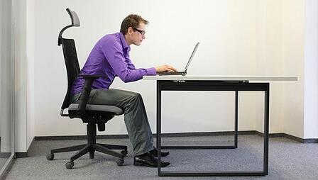 Man sitting with poor posture