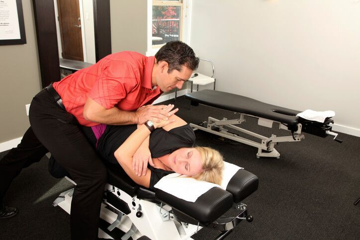 Chiropractor performing a side posture adjustment in Decatur, Georgia