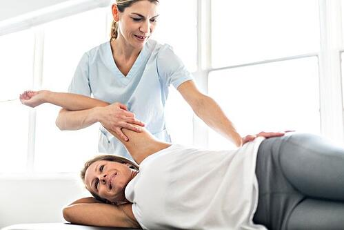 Chiropractor performing a back adjustment