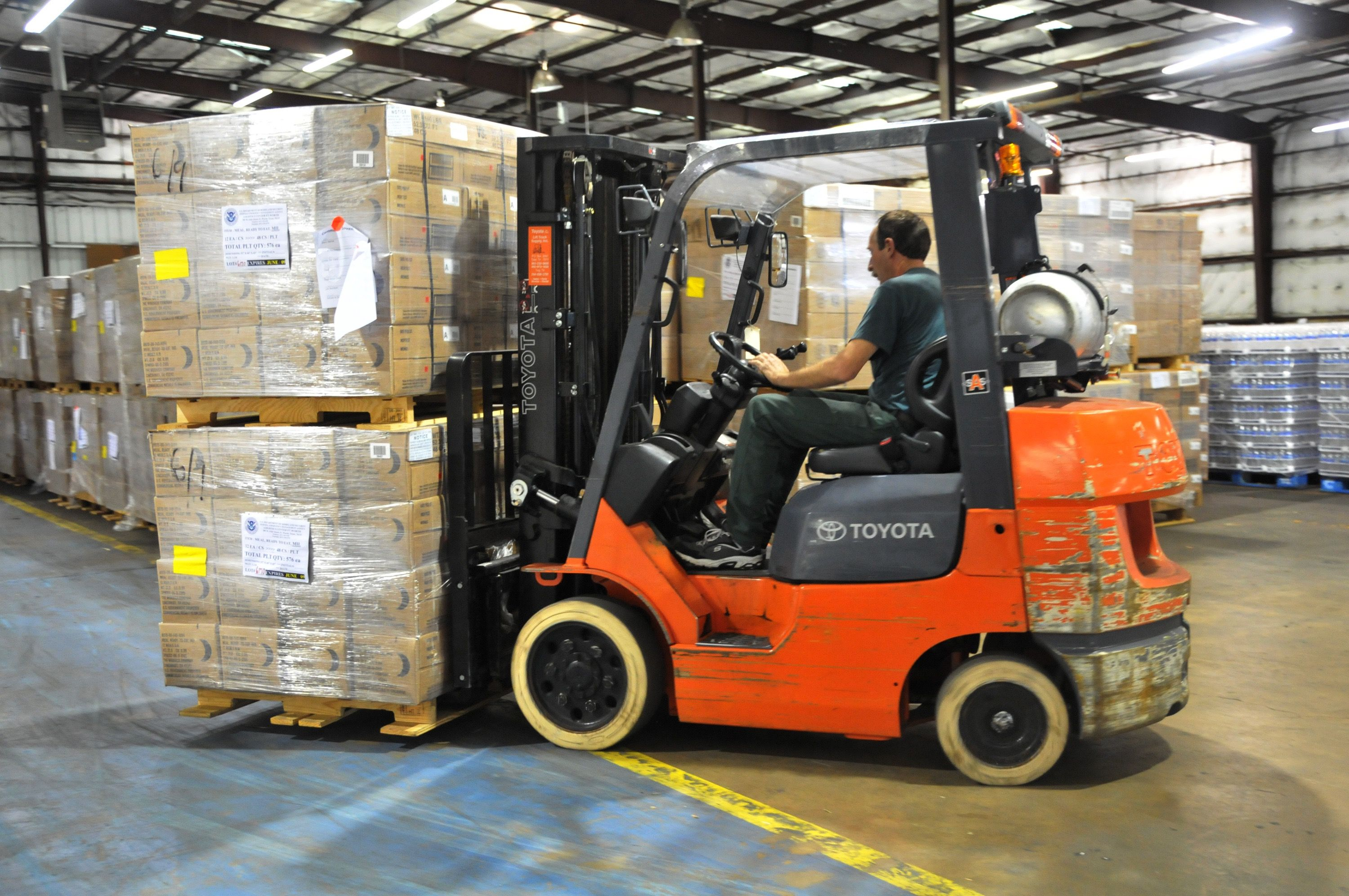 FEMA_-_37931_-_Meals_Ready_to_Eat_being_moved_by_fork_lift_in_a_Texas_warehouse-1