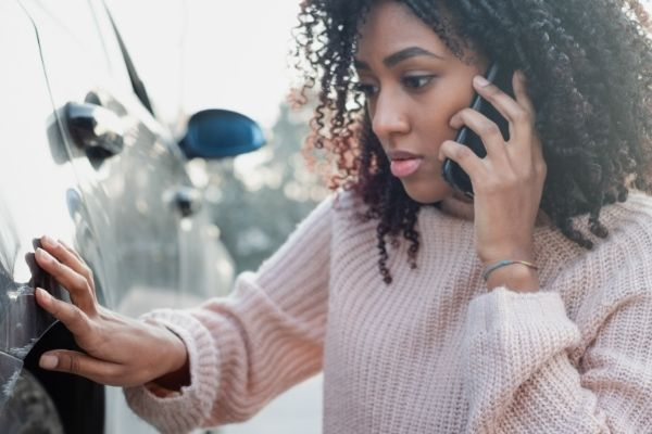 woman-speaking-to-an-attorney-in-register-after-a-car-wreck
