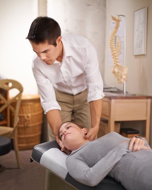 Chiropractor in Stockbridge performing a neck adjustment