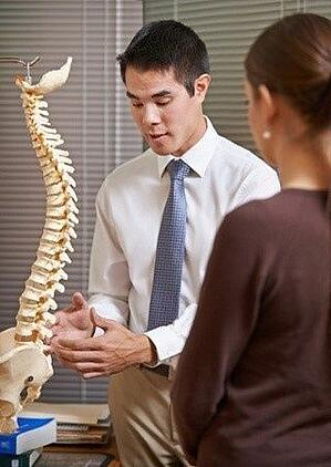 Arrowhead Chiropractor discussing treatment with Canton, GA patient