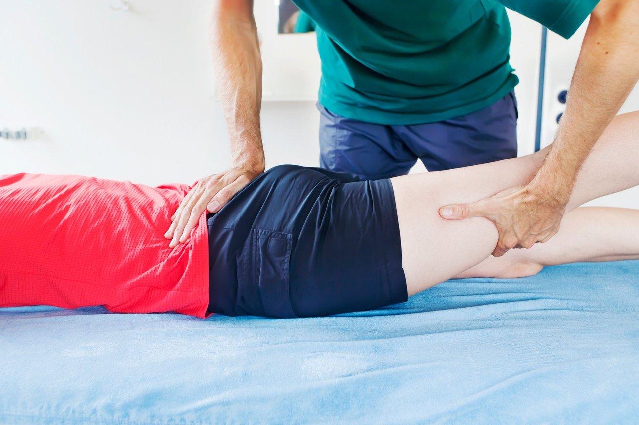 Chiropractor adjusting patient in Columbus