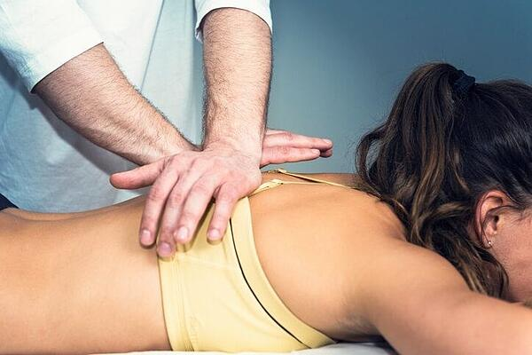 Marietta chiropractor adjusting a patient with back pain
