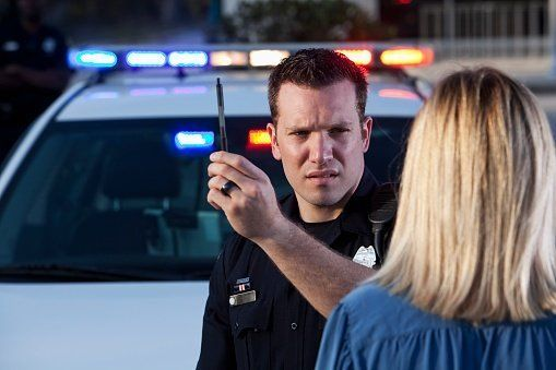 Police Officer Conducting a Sobriety Test