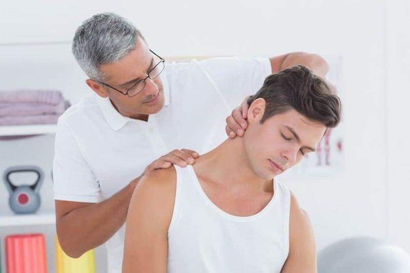 Atlanta Chiropractor examining patient