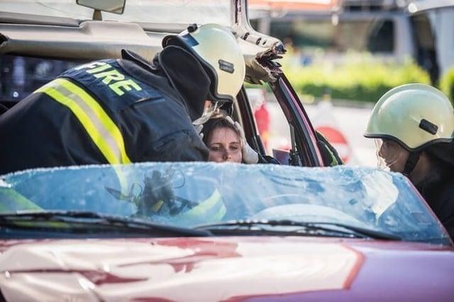 EMT helping injured accident victim