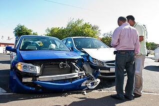 Men talking after a car accident