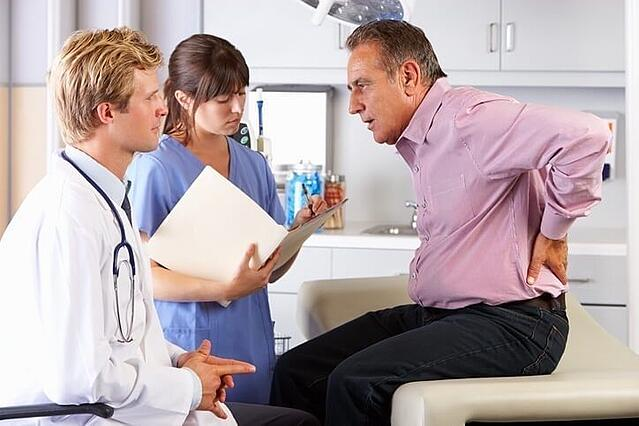 man meeting with chiropractor after an accident injury