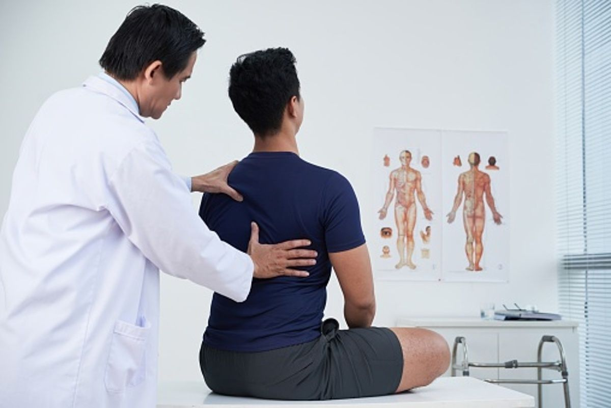 How should you take care of back pain after a car accident?