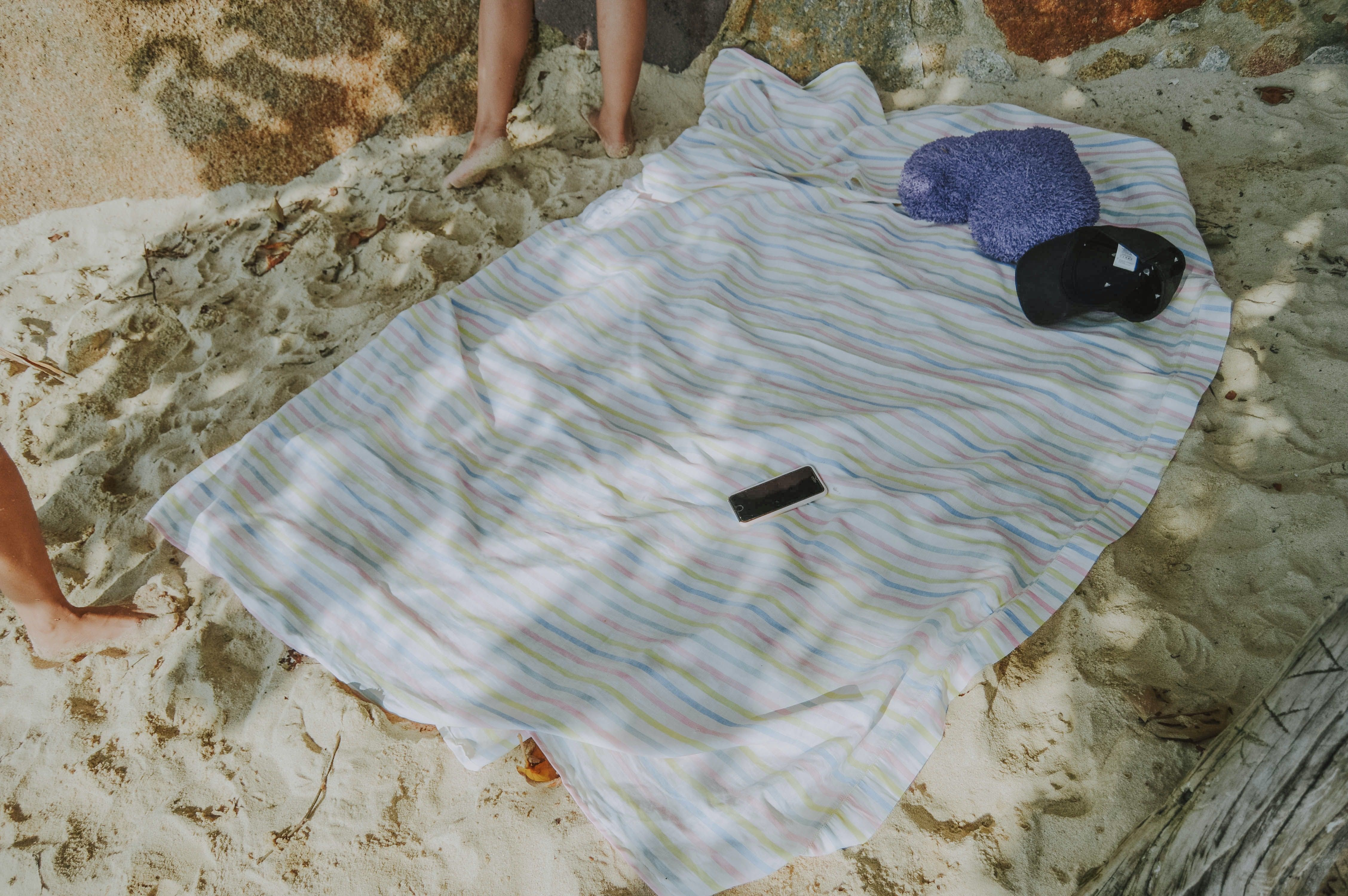 A beach blanket makes a wonderful divider between beach goers.
