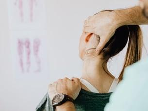 midtown-chiropractor-gives-patient-a-neck-adjustment