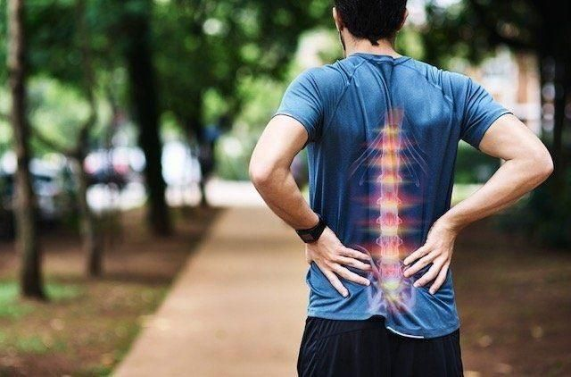 man with a painful back needs treatment from arrowhead clinic