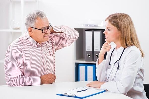 Chiropractor consulting with a patient