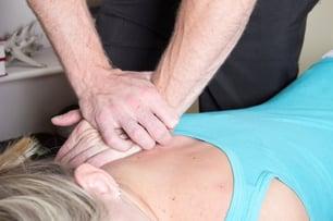Chiropractor adjusting a patient
