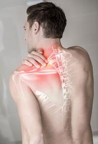 Man with pain in traps and shoulders from a cervical subluxation