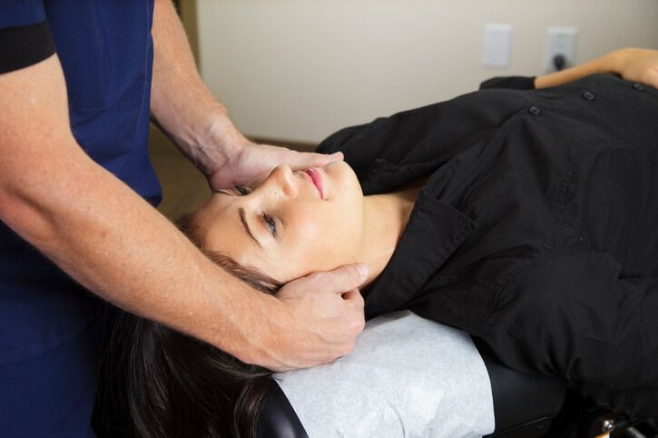 Chiropractor treating a patient with a neck injury