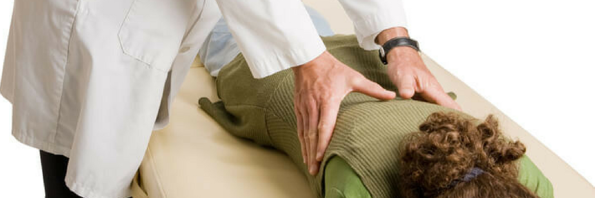 Chiropractor adjusting the Thoracic Spine
