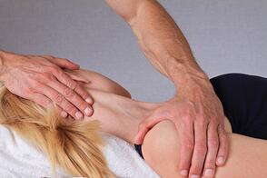 Chiropractor Treating a Whiplash Injury after a Car Accident